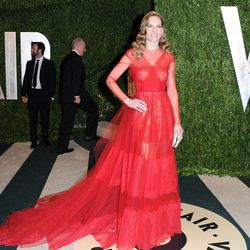 """Hilary Swank's red dress looks like a safer version of Rihanna's <a href=""""http://la.racked.com/archives/2013/02/11/grammys_2013_rihanna_scores_in_alaia_cbs_memo_a_joke.php"""">stand-out Alaïa</a>."""
