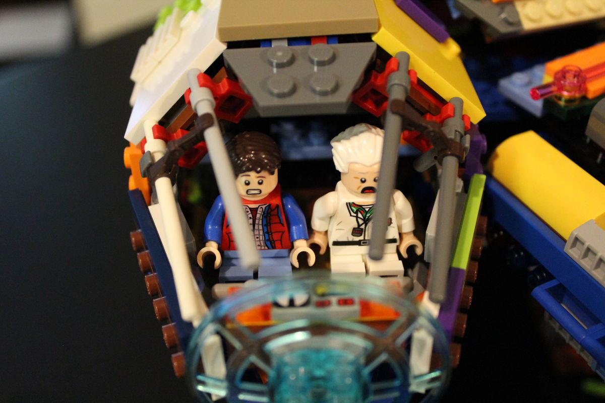 Doc and Marty from Back to the Future fly a Lego Millennium Falcon