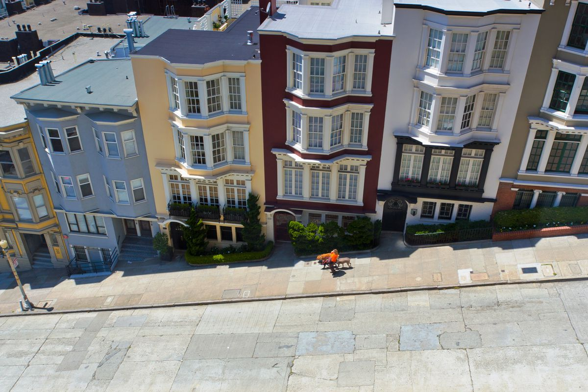 An above shot of buildings of descending height on a San Francisco hill