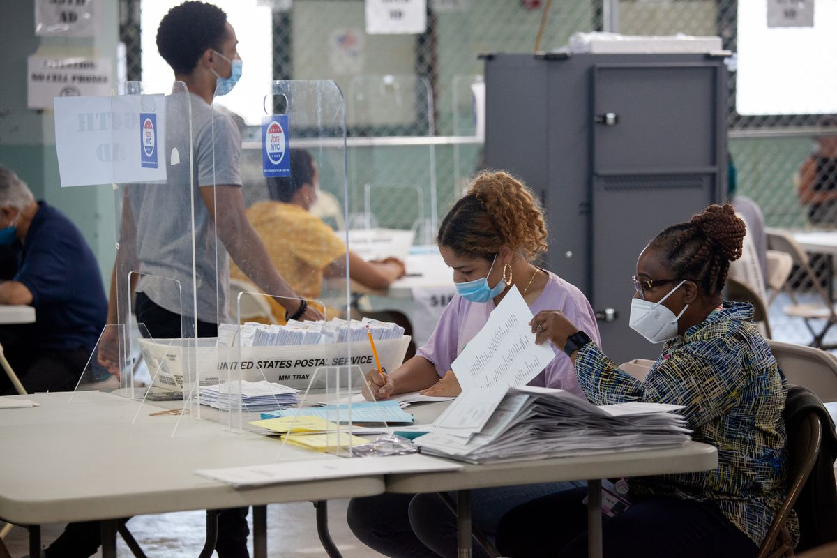 Board of Election workers tally ballots in Sunset Park, Brooklyn, June 29, 2021.