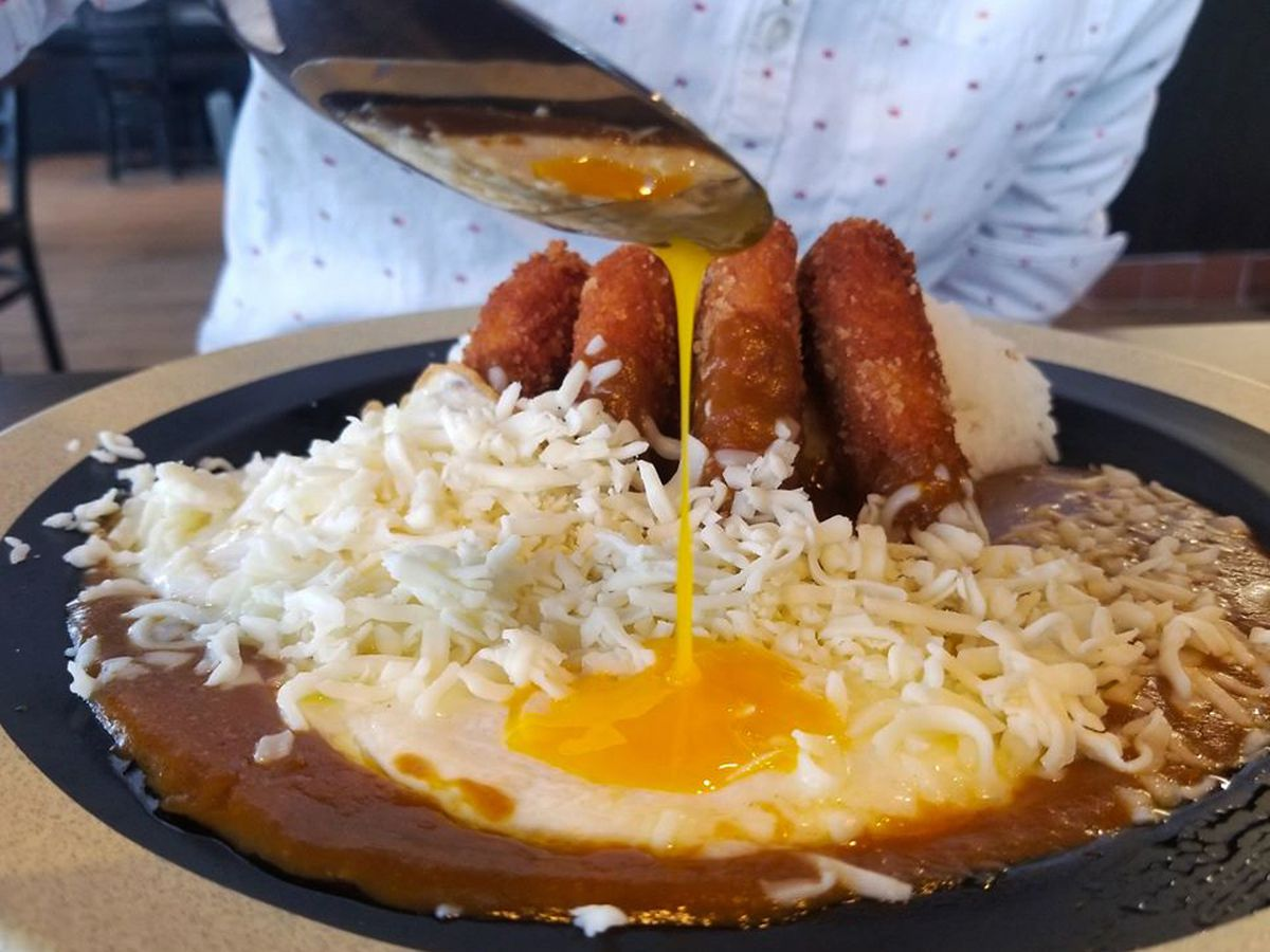 A katsu curry dish topped with a fried egg, available for takeout and delivery Zen Curry Dining.