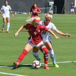 Kansas State's Hannah Davis (22) tangles with Oklahoma's Lauren Haivala (7) during the Wildcats' loss to the Sooners on Sunday, Sept. 23, 2018, in Manhattan.