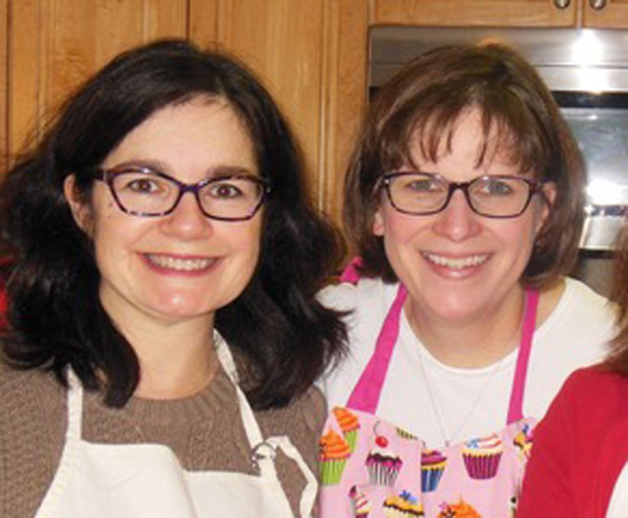 Kathleen Lyons (left) with her friend Eileen Womac, who has agreed to donate a portion of her liver to Lyons for a transplant, seen here at a holiday cookie-baking party.
