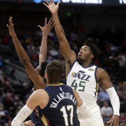 Utah Jazz guard Donovan Mitchell (45) shoots over New Orleans Pelicans center Jonas Valanciunas (17) during a preseason NBA game at the Vivint Smart Home Arena in Salt Lake City on Monday, Oct. 11, 2021.