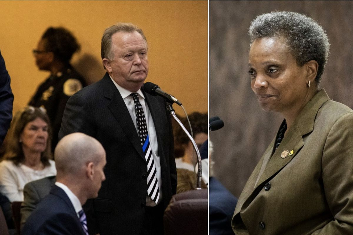 Fraternal Order of Police official Patrick Murray (left) and Mayor Lori Lightfoot.