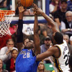 Utah Jazz center Al Jefferson (25) blocks the duck attempt of Dallas Mavericks center Ian Mahinmi (28) as the Utah Jazz and the Dallas Mavericks play Monday, April 16, 2012 in Salt Lake City.