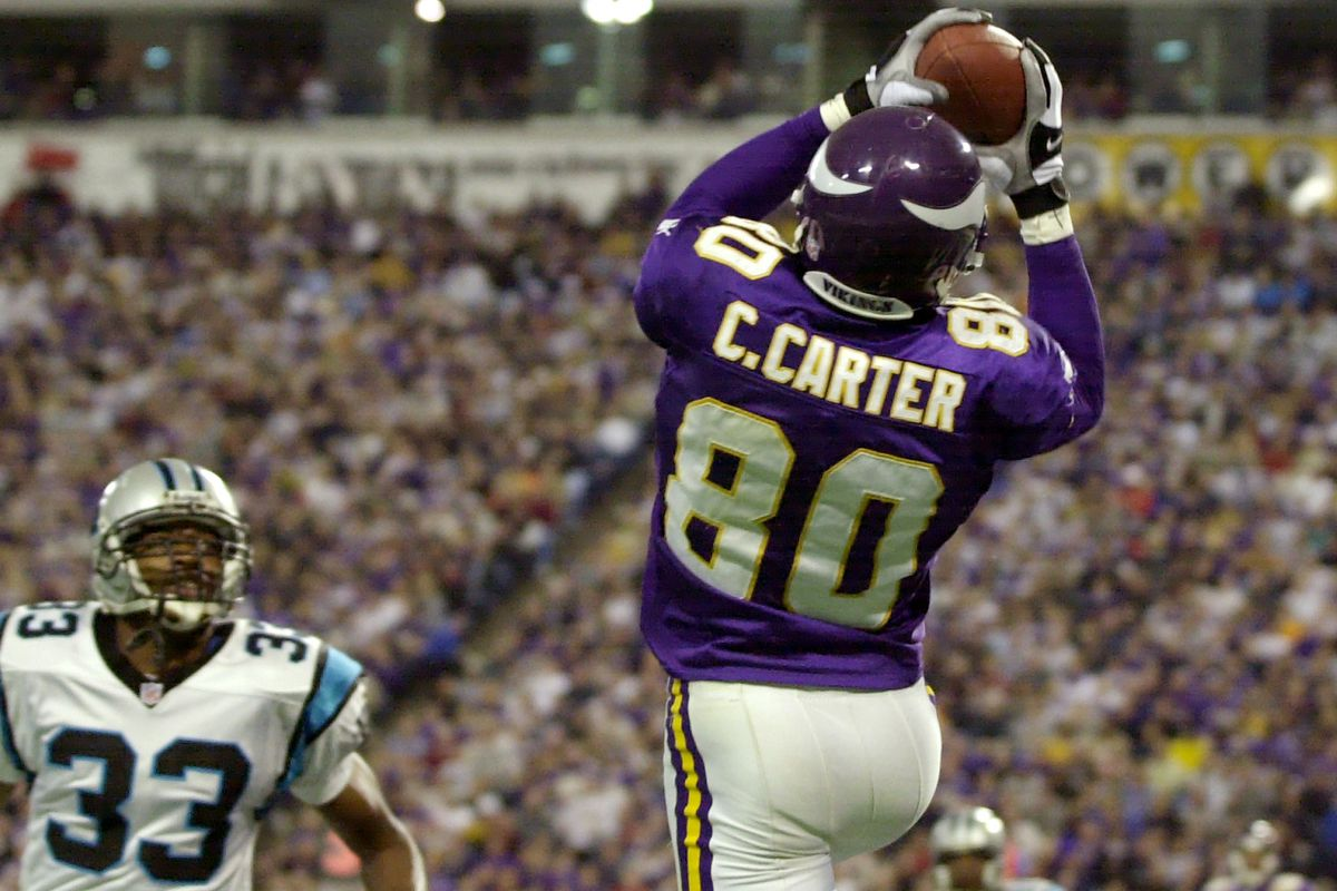 Minnesota Vikings Cris Carter Pulls down a 15 yard touchdown pass in the 3rd quarter touchdown over Carolina Panthers Doug Evans 33.(Photo By JERRY HOLT/Star Tribune via Getty Images)