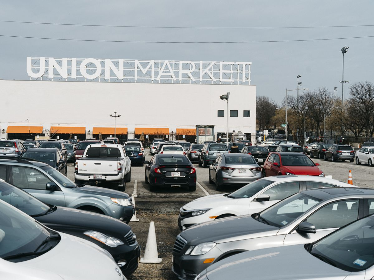 The exterior of Union Market in Washington D.C. There is a parking lot in front.