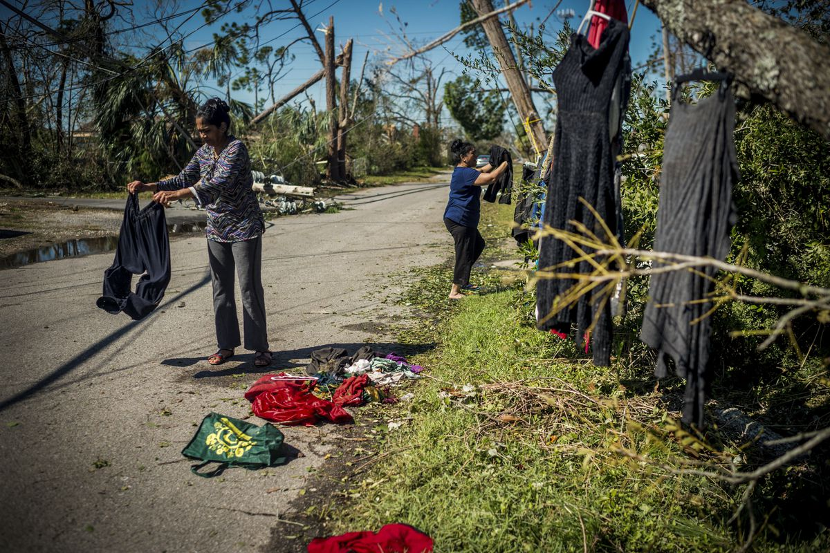 October 11: A family hangs clothes to dry outside a downed tree by their house in Panama City, Florida. Residents of the Florida Panhandle woke to scenes of devastation after Hurricane Michael tore a path through the coastal region killing at least two pe