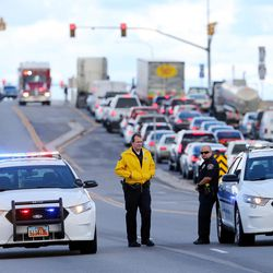 West Valley City police officers block 5600 West as firefighters respond to a junkyard fire on Monday, Oct. 17, 2016.