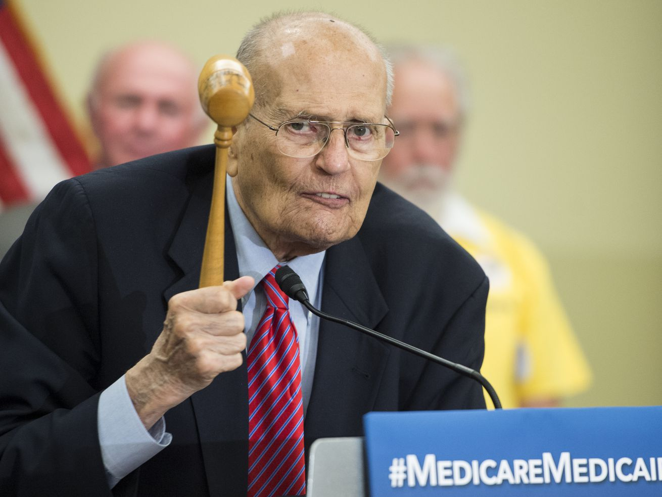 Rep. John Dingell, who died at age 92 on Thursday, celebrates the 50th anniversary of Medicare's passage in 2015 with the gavel he used to preside over that historic vote.