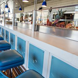 The upstairs bar at BeetleCat in Atlanta gets a up close and personal view of all of the fresh seafood.