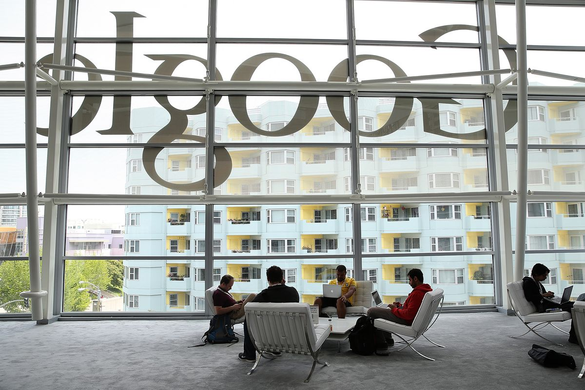 Developers sit in front of window at a Google office in San Francisco