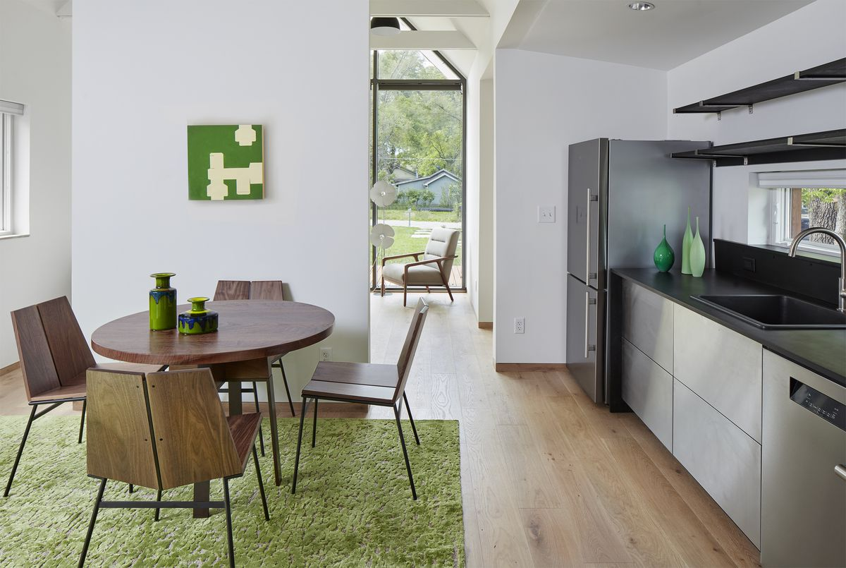 Kitchen with modern appliances and dining table.