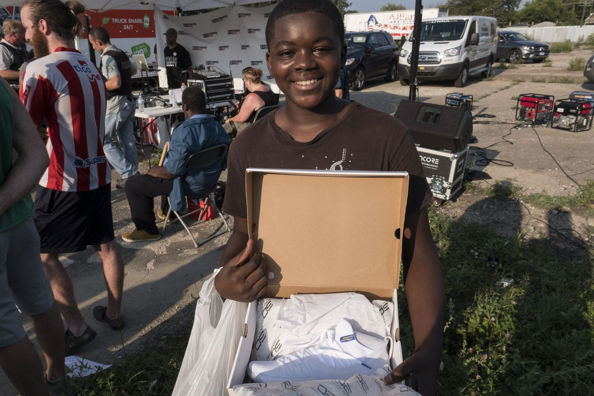 Brandon Lott, 13, poses with his new shoes that he got from Vic Mensa's foundation, Save Money Save Lifes shoe give away event.   Rick Majewski/For the Sun-Times