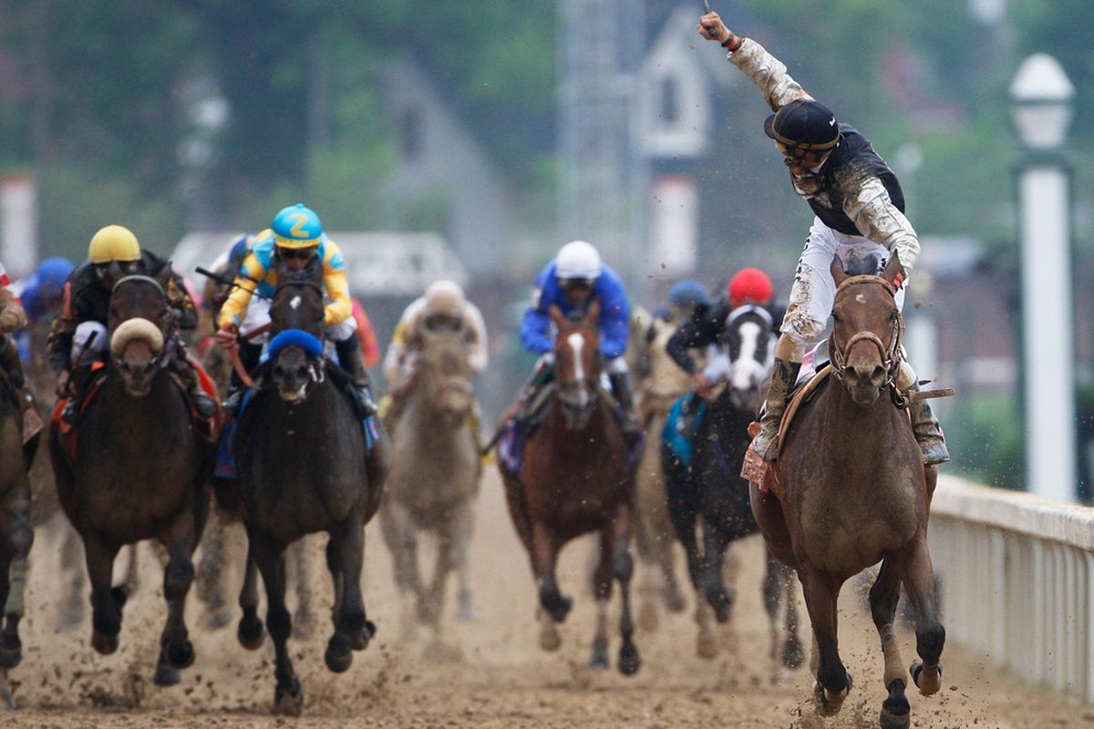 LOUISVILLE, KY - MAY 02: Jockey Calvin Borel atop Mine That Bird crosses the finish line to win the 135th running of the Kentucky Derby on May 2, 2009 at Churchill Downs in Louisville, Kentucky. (Photo by Jamie Squire/Getty Images)