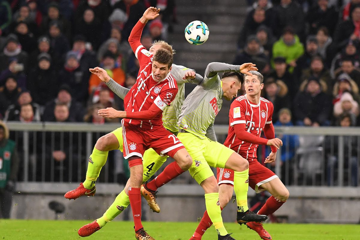 MUNICH, GERMANY - DECEMBER 13: Thomas Mueller (C) of Bayern Munich in action during the Bundesliga soccer match between FC Bayern Munich and 1. FC Cologne at the Allianz Arena on December 13, 2017, in Munich, Germany.
