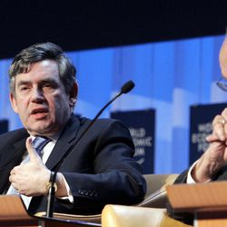 FILE - In this Friday Jan. 26, 2007 file photo the then Chancellor of the Exchequer of Britain, Gordon Brown, left, gestures while speaking at the World Economic Forum in Davos, Switzerland, as Chairman and CEO of News Corporation Rupert Murdoch listens.