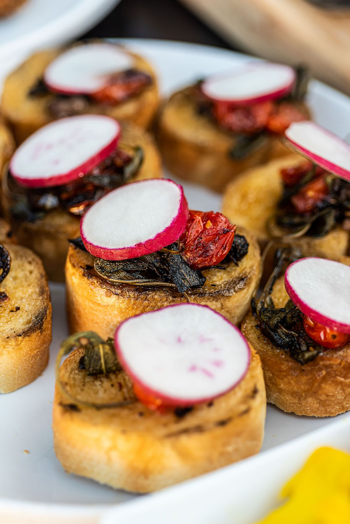 Bone marrow over toast with a large ring of radish on top.