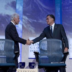 Former President Bill Clinton shakes hands with Republican presidential candidate, former Massachusetts Gov. Mitt Romney after he spoke at the Clinton Global Initiative convention in New York, Tuesday, Sept. 25, 2012.
