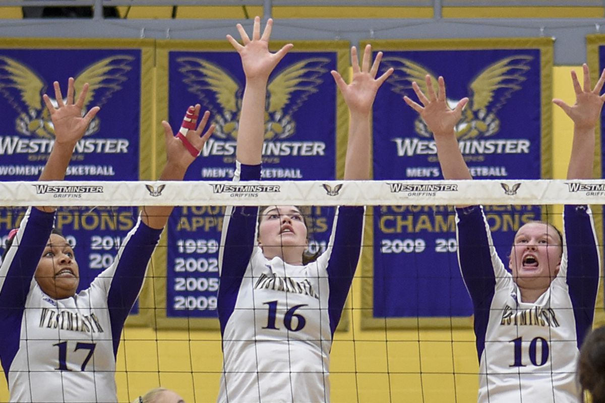 Whitney Wakefield (left), Sydnee Simmons (center) and Amber Lamborn (right) go for a block.