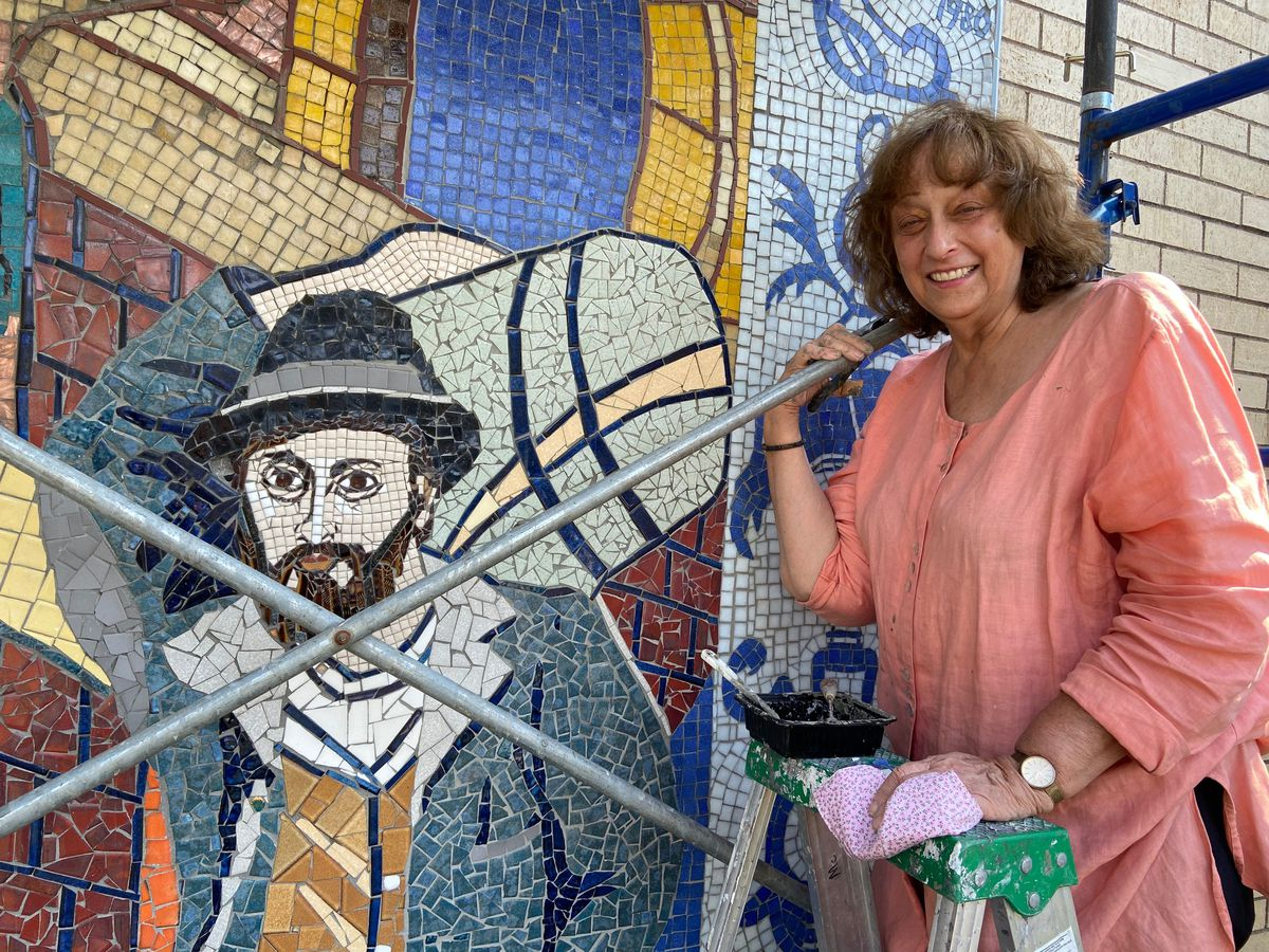 """Artist Miriam Socoloff when she was working on restoring the """"Fabric of Our Lives"""" mosaic 40 years after its creation."""