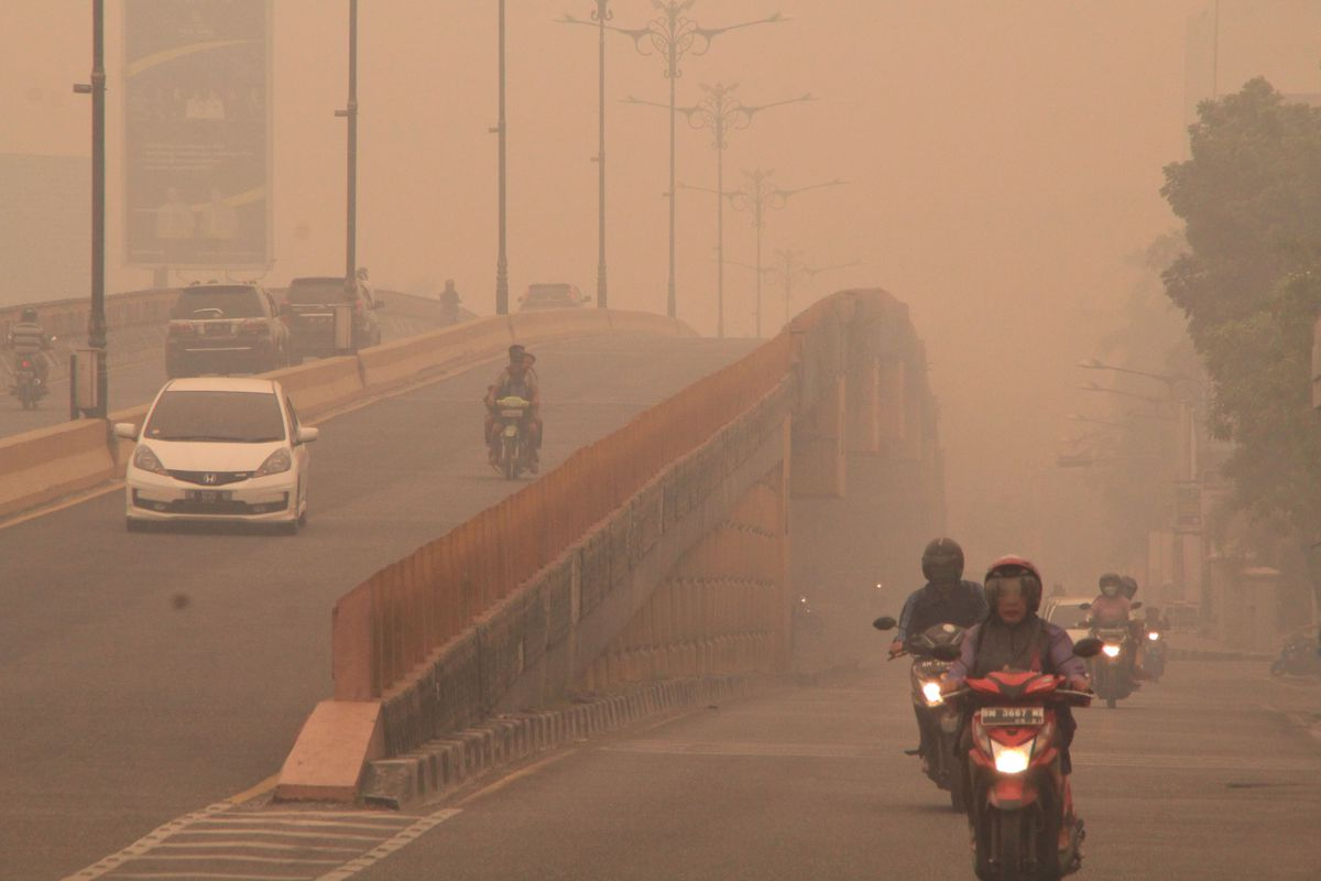 A view of Pekanbaru city cover haze caused forest fire on September 22, 2019 in Pekanbaru city, Riau province, Indonesia.
