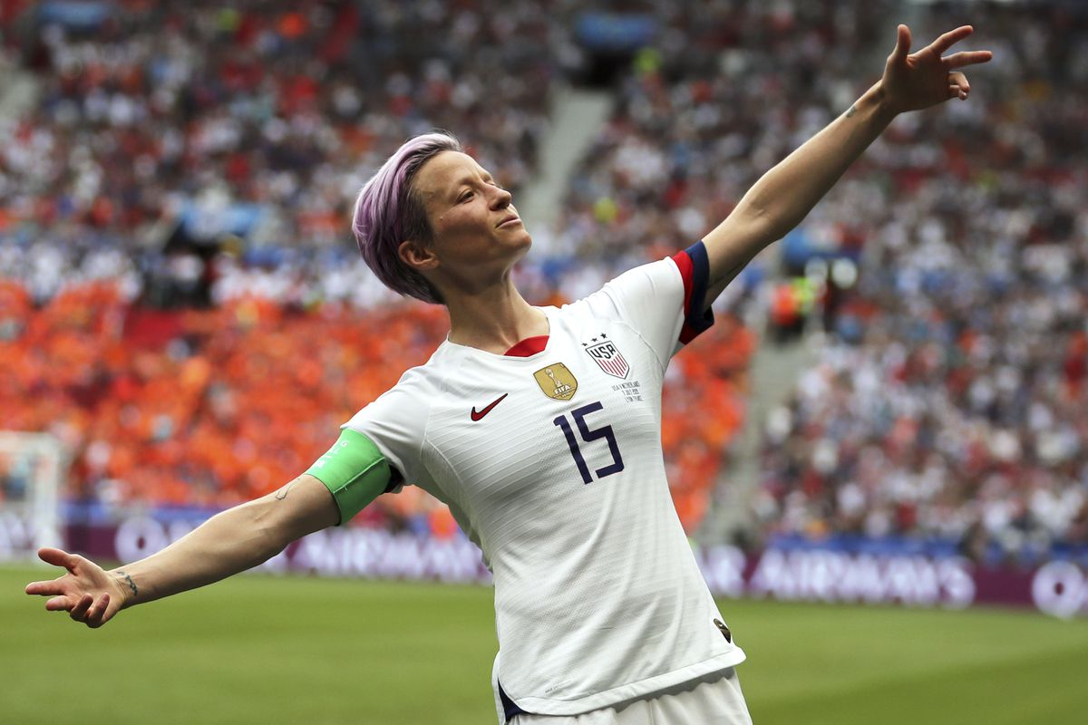 Megan Rapinoe celebrates after scoring the opening goal from the penalty spot during the Women's World Cup final soccer match between US and The Netherlands at the Stade de Lyon in Decines, outside Lyon, France, Sunday, July 7, 2019.