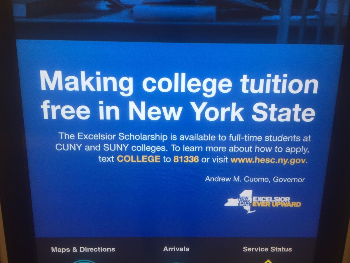 An advertisement for the Excelsior Scholarship at a subway stop.