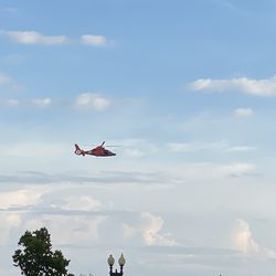 A Coast Guard helicopter flies over the Potomac River near the Tidal Basin