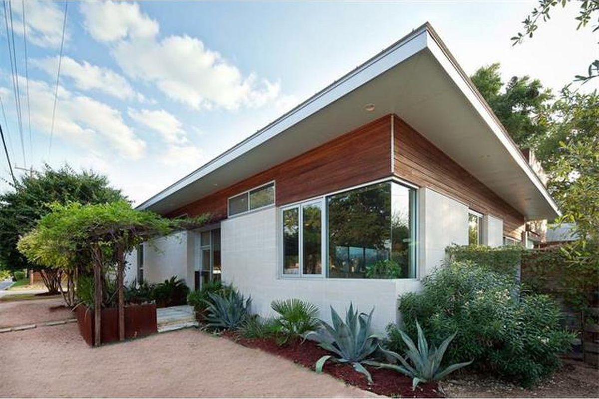 Contemporary home exterior wood, stucco, metal