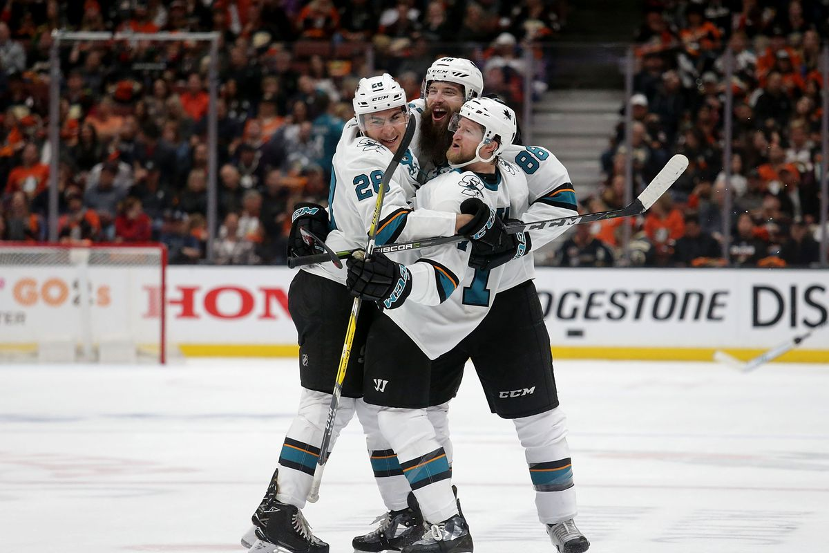 ANAHEIM, CA - APRIL 12: (L-R) Timo Meier #28, Brent Burns #88 and Paul Martin #7 of the San Jose Sharks celebrate Burns' goal in the second period against the Anaheim Ducks in Game One of the Western Conference First Round during the 2018 NHL Stanley Cup