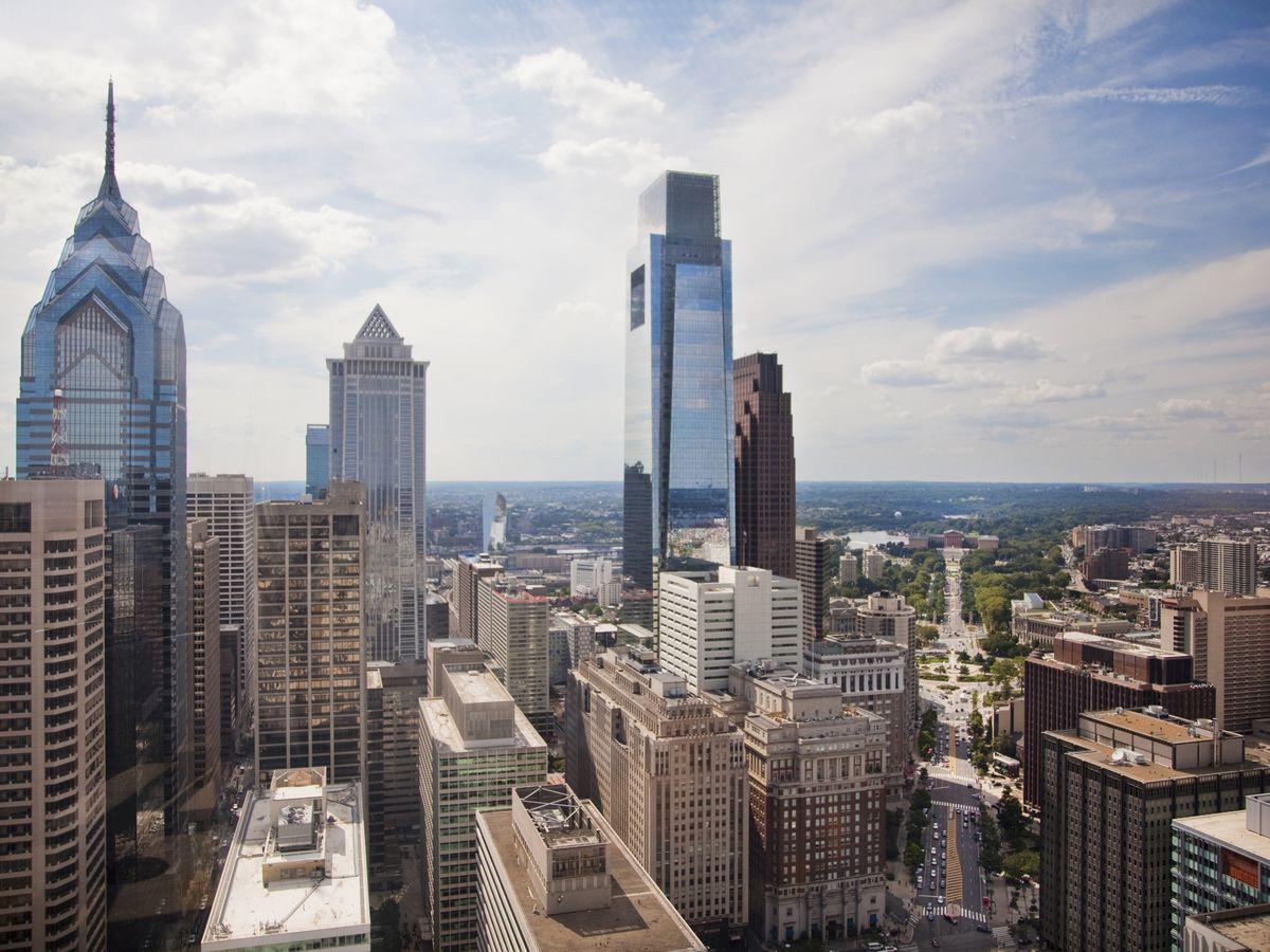 An aerial view of the skyline of Philadelphia with the Philadelphia City Hall.
