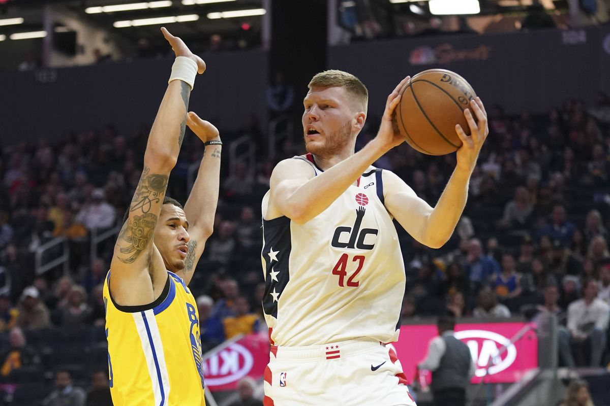 Washington Wizards forward Davis Bertans passes the basketball against Golden State Warriors forward Juan Toscano-Anderson during the second quarter at Chase Center.