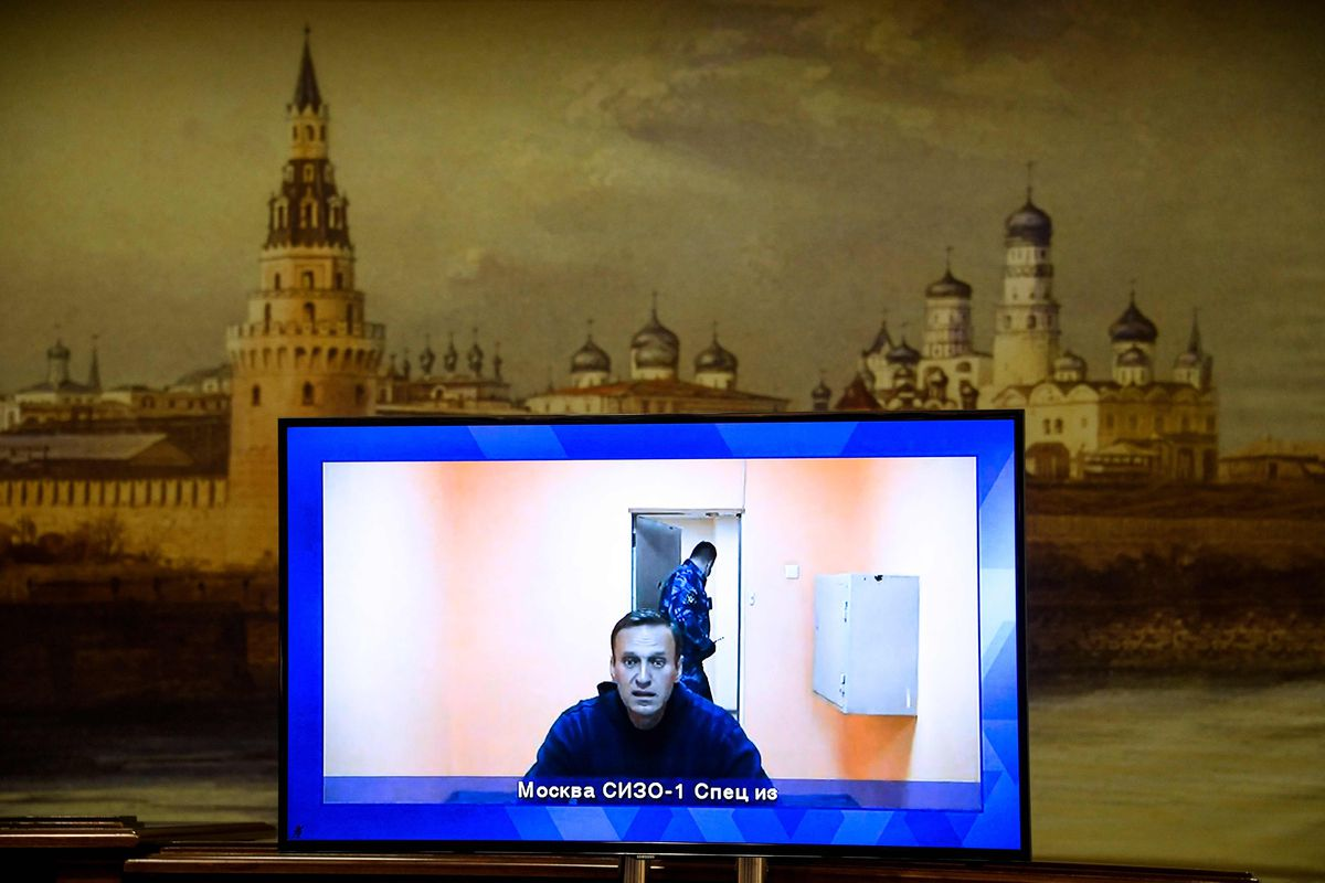 Opposition leader Alexei Navalny appears on a screen set up at a hall of the Moscow Regional Court via a video link from Moscow's penal detention centre Number 1 (known as Matrosskaya Tishina) during a court hearing of an appeal against his arrest, in Krasnogorsk outside Moscow on January 28, 2021.