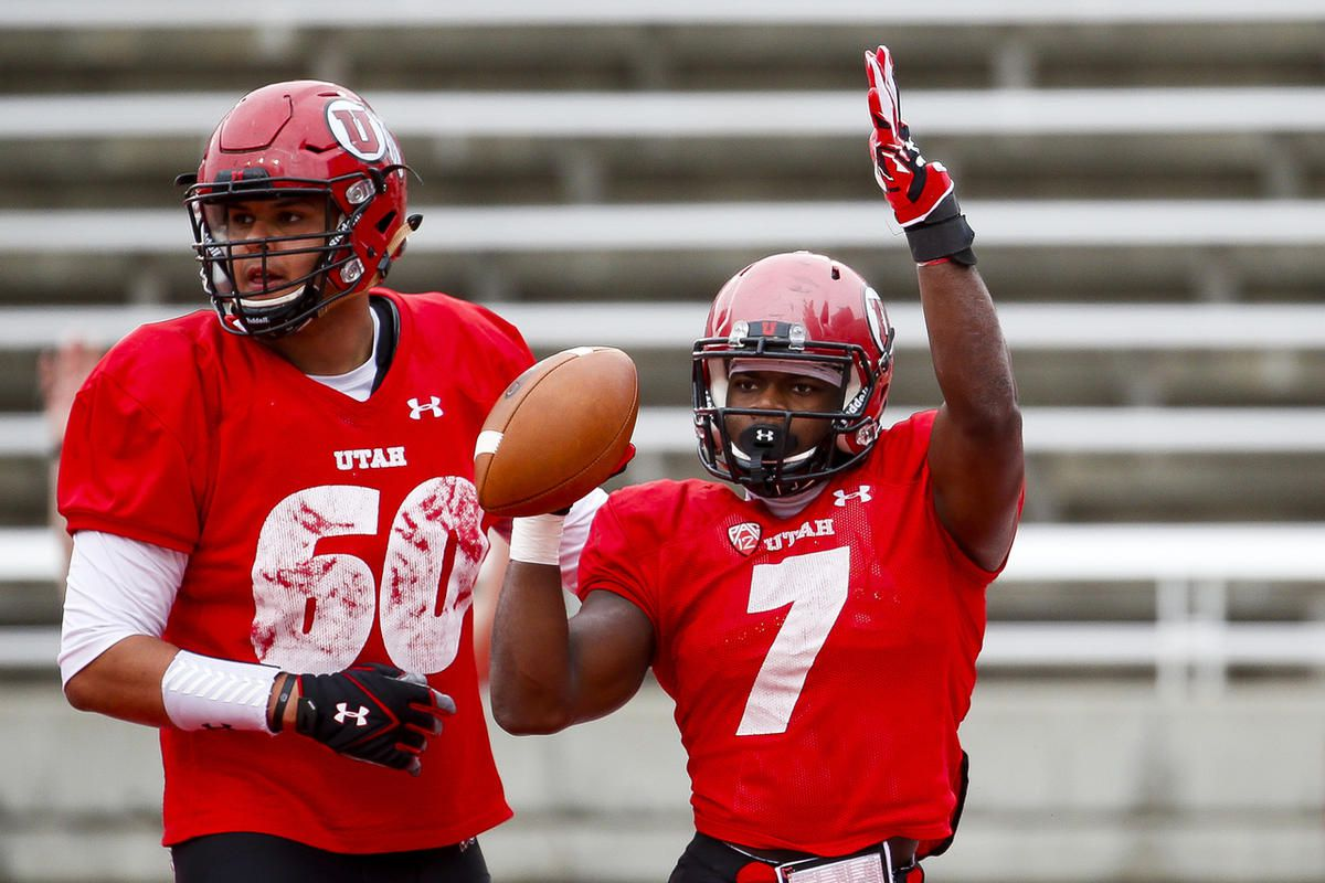 Devonta'e Henry-Cole celebrates a touchdown with Keven Dixon during a scrimmage at Rice-Eccles Stadium in Salt Lake City on Tuesday, April 11, 2017. Henry-Cole entered the transfer portal in January and signed with rival BYU in February. He spoke publicly to the Deseret News for the first time about his decision to transfer to BYU.