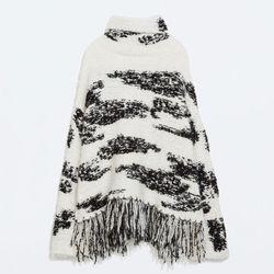 """Zara patterned poncho sweater, <a href=""""http://www.zara.com/us/en/woman/knitwear/patterned-knit-poncho-c269190p2358001.html"""">$99.90</a>"""