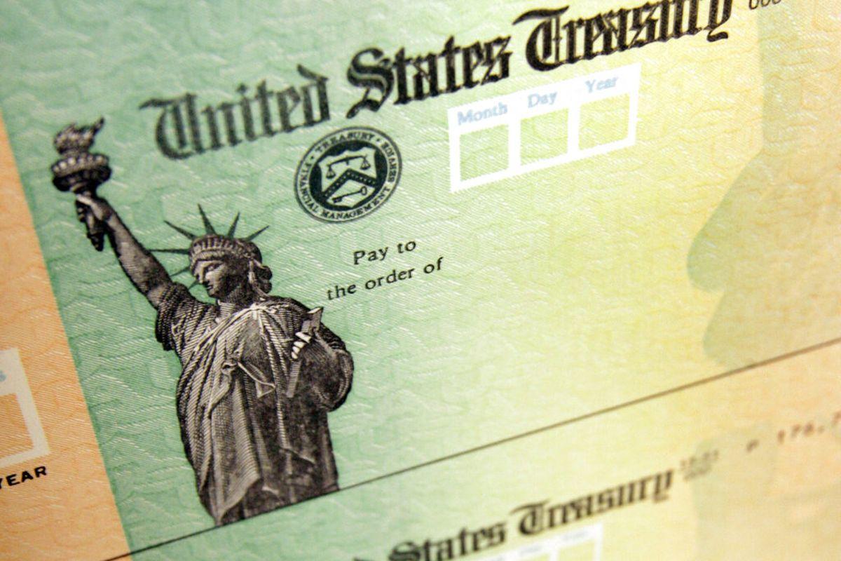 Blank stimulus checks on an idle press at the Philadelphia Regional Financial Center.