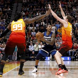 Utah Jazz's Jae Crowder (99) and Joe Ingles, right, defend as Minnesota Timberwolves' Jeff Teague, middle, looks to pass during the first half of an NBA basketball game Friday, March 2, 2018, in Salt Lake City.