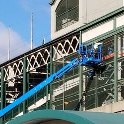 Worker on south face of ballpark