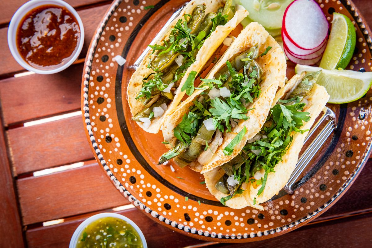 Taqueria Xochi co-owner Geraldine Mendoza says authentically Mexican tacos — like these nopales-filled tortillas — have only onion and cilantro as a garnish with salsa on the side