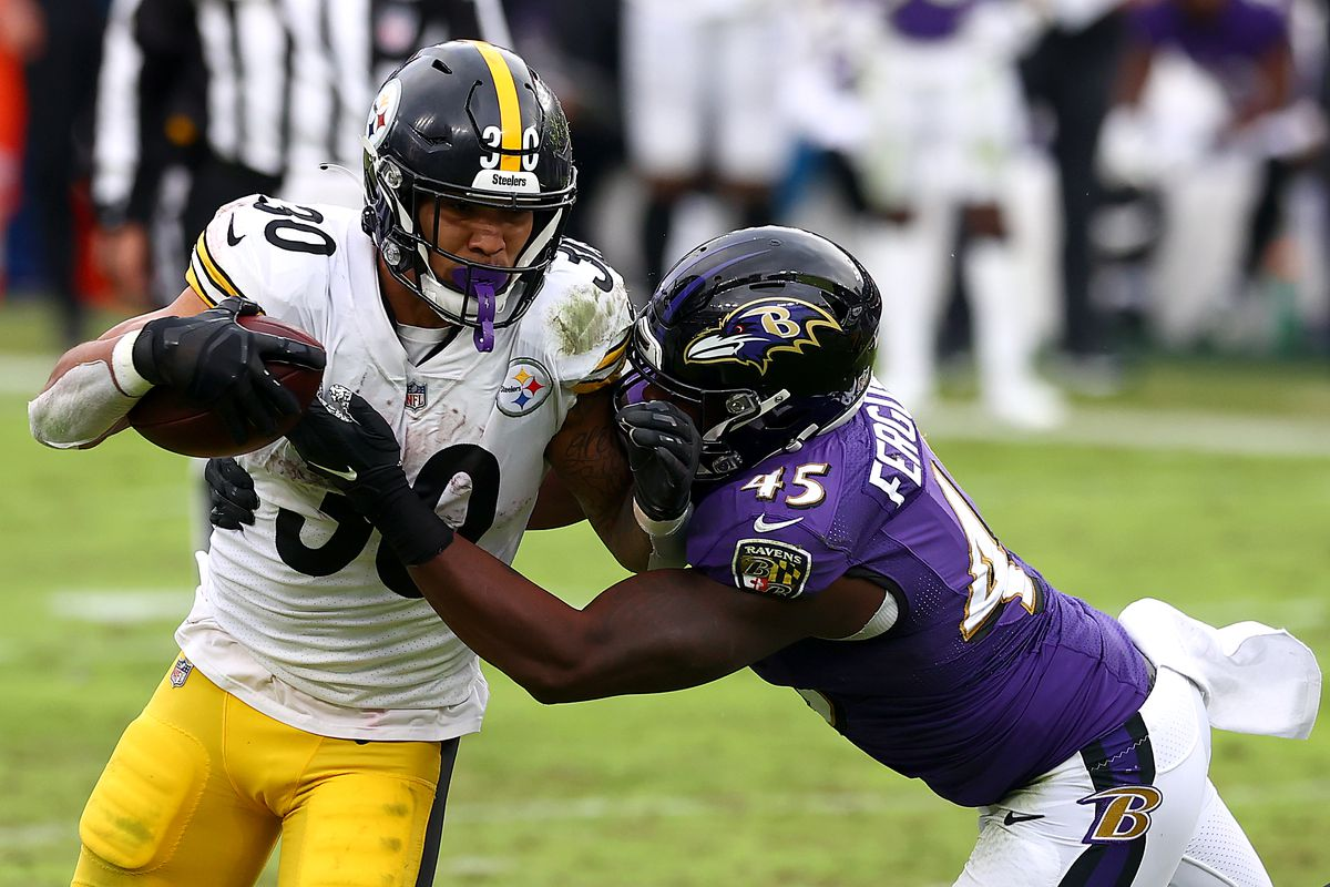 Running back James Conner #30 of the Pittsburgh Steelers is tackled by linebacker Jaylon Ferguson #45 of the Baltimore Ravens in the third quarter at M&T Bank Stadium on November 01, 2020 in Baltimore, Maryland.