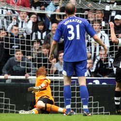 Newcastle United's Hatem Ben Arfa, right, scores his goal past Bolton Wanderers' goalkeeper Adam Bogdan, left,  during their English Premier League soccer match at the Sports Direct Arena, Newcastle, England, Monday, April 9, 2012.
