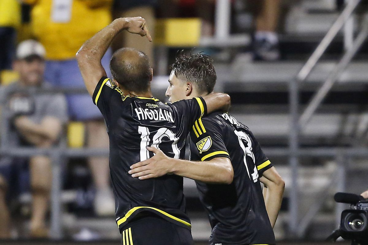 Federico Higuain and Ethan Finlay celebrate a second-half goal that earned Columbus Crew SC a 1-1 draw with Los Angeles Galaxy on Saturday in Columbus.