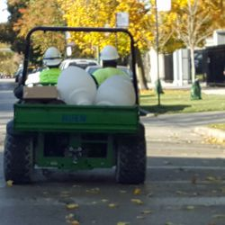 10:49 a.m. Workers drive decorative light globes to Green Lot -