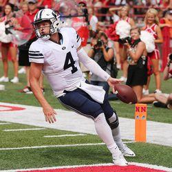 BYU quarterback Taysom Hill (4) scores against Nebraska in Lincoln, Nebraska, Saturday, Sept. 5, 2015.