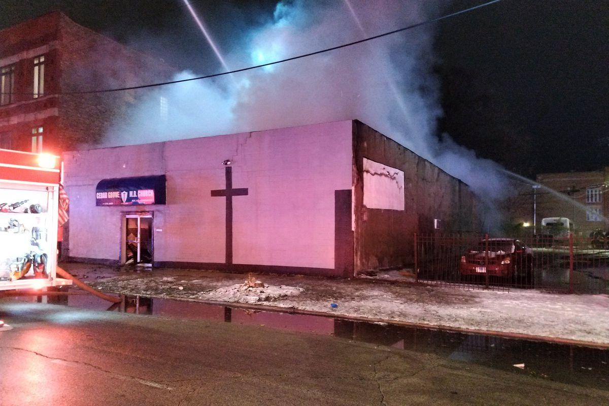 Crews work to extinguish a fire at Cedar Grove Missionary Baptist Church