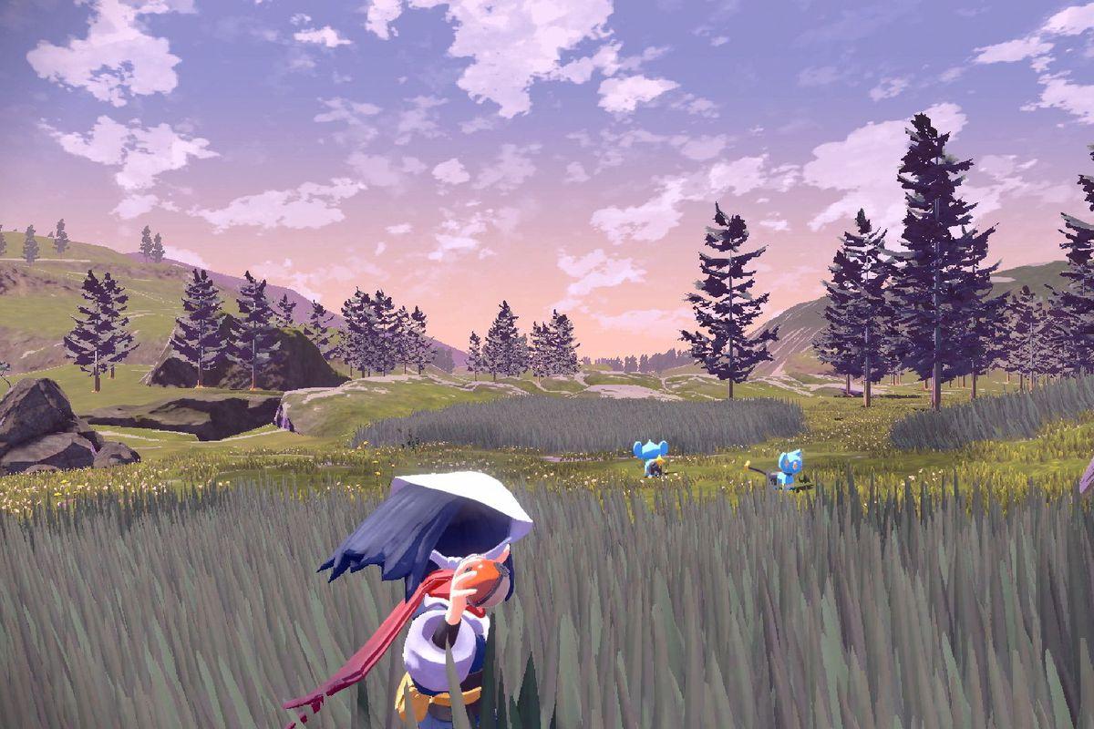 a girl standing in tall grass throwing a Poké Ball in Pokémon Legends: Arceus