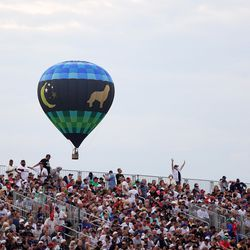 A hot air balloon is seen during the third inning.