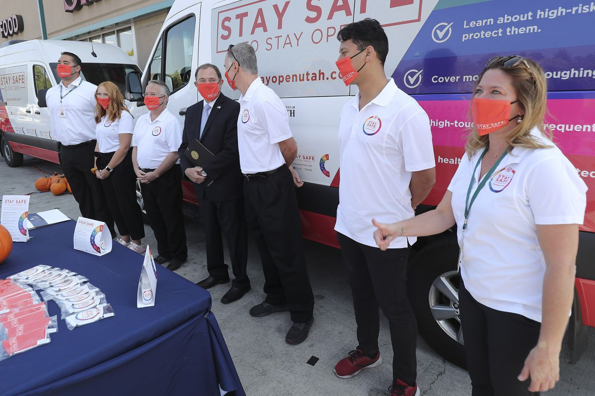 Gov. Gary Herbert stands with Stay Safe to Stay Open ambassadors during thekick off of the campaign'sstatewide van tourin a Smith's parking lot in Salt Lake City on Thursday, Oct. 1, 2020.